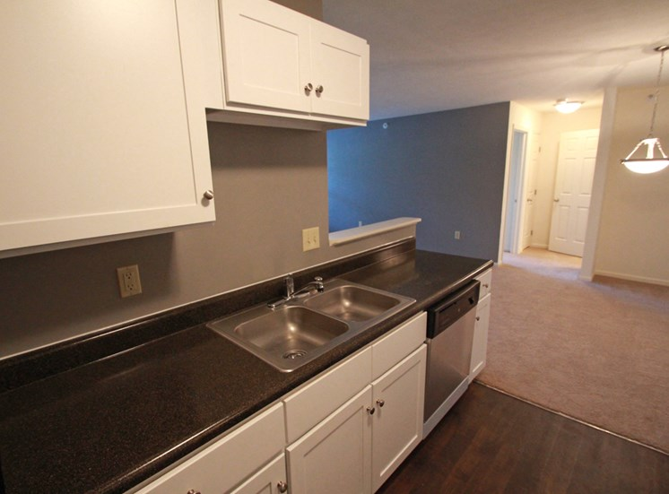 This is a photo of an upgraded kitchen in the 1056 square foot 2 bedroom Gainsway at Trails of Saddlebrook Apartments in Florence, KY.