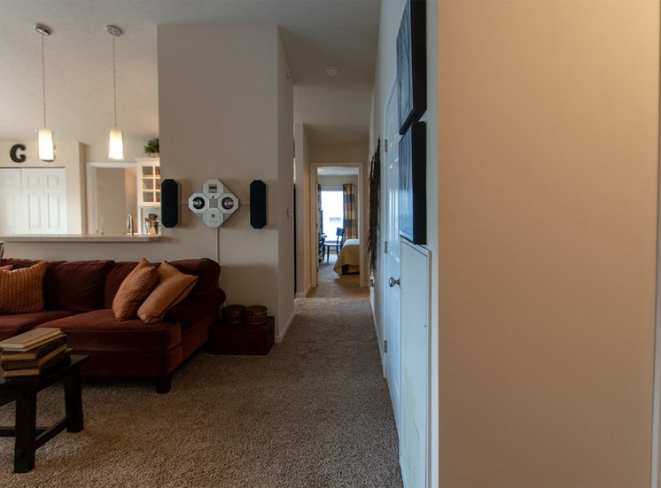 This is a photo looking down the hallway from the living room in the 1016 square foot, 2 bedroom Nautica floor plan at Nantucket Apartments in Loveland, OH.