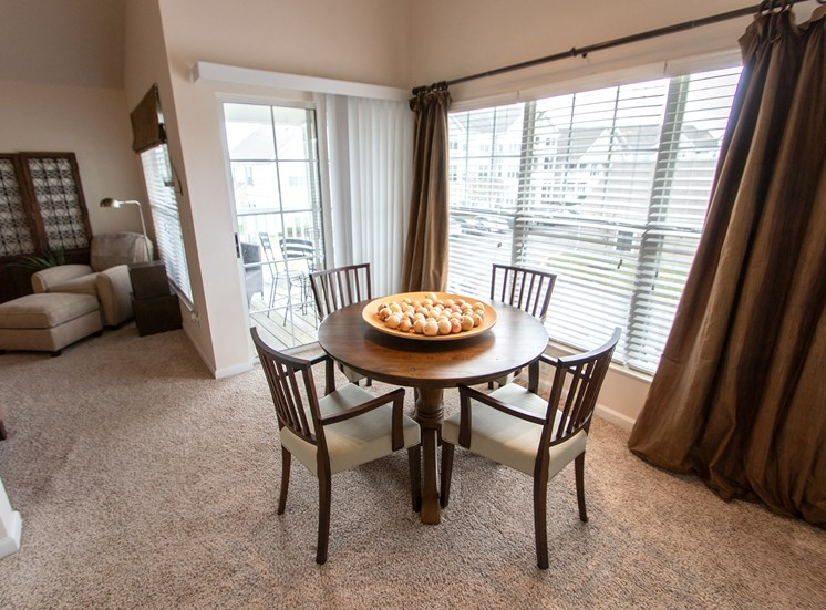 This is a photo of the dining room in the 1016 square foot, 2 bedroom Nautica floor plan at Nantucket Apartments in Loveland, OH.