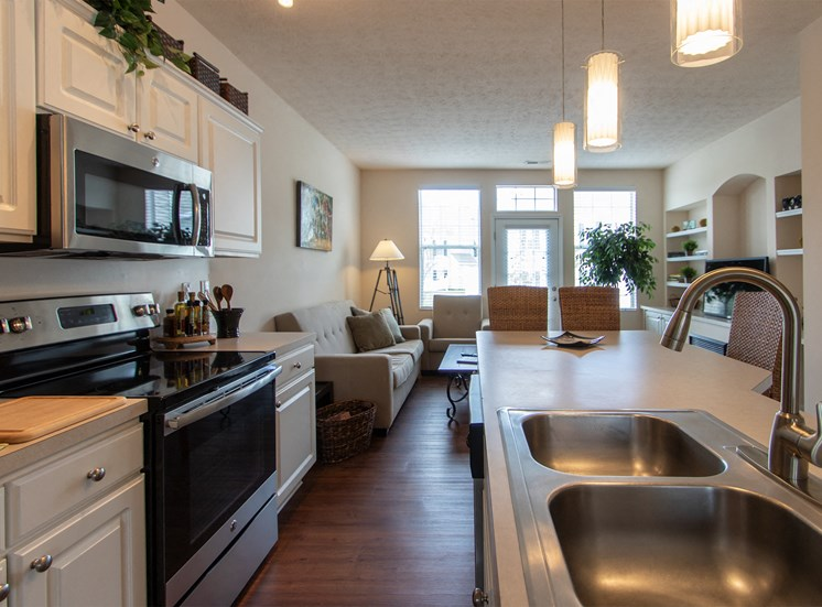 This is a photo of the kitchen in the 1242 square foot, 2 bedroom Spinnaker floor plan at Nantucket Apartments in Loveland, OH.