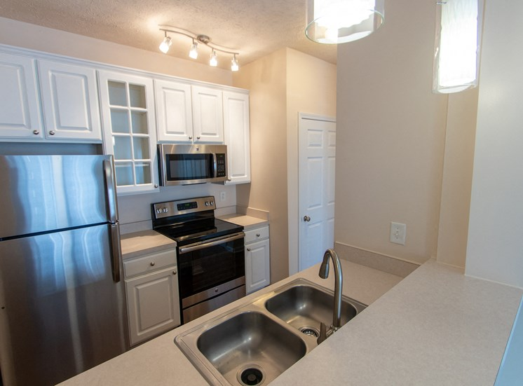 This is a photo of the kitchen in the 563 square foot, 1 bedroom Catamaran floor plan at Nantucket Apartments in Loveland, OH.