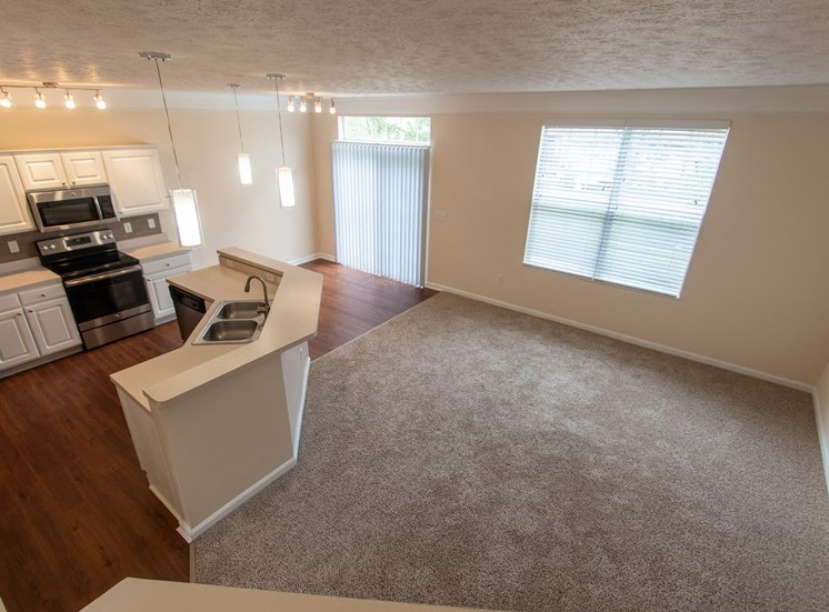 This is a photo of the living room in the 1578 square foot, 3 bedroom Flagship floor plan at Nantucket Apartments in Loveland, OH.