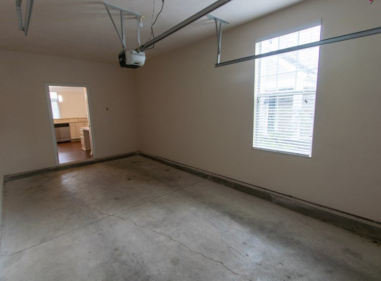 This is a photo of the attached single car garage in the 1578 square foot, 3 bedroom Flagship floor plan at Nantucket Apartments in Loveland, OH.