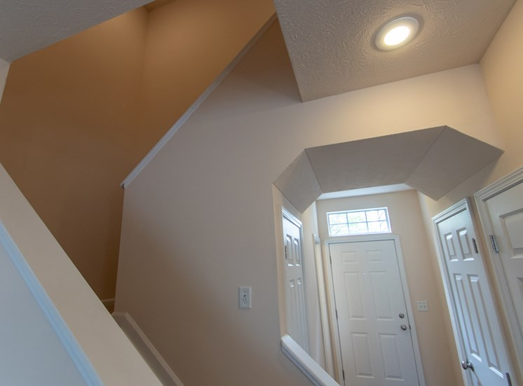 This is a photo of the stairway and entryway in the 1578 square foot, 3 bedroom Flagship floor plan at Nantucket Apartments in Loveland, OH.