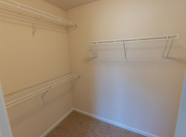 This is a photo of the second bedroom walk-in closet in the 1578 square foot, 3 bedroom Flagship floor plan at Nantucket Apartments in Loveland, OH.