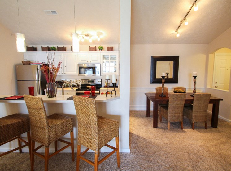This is a photo of the kitchen/dining room in the 2 bedroom Atlantic floor plan at Nantucket Apartments in Loveland, OH.