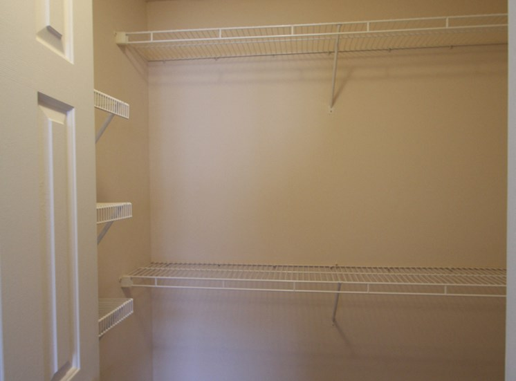 This is a photo of the walk-in closet in the 1 bedroom Patriot floor plan at Nantucket Apartments in Loveland, OH.