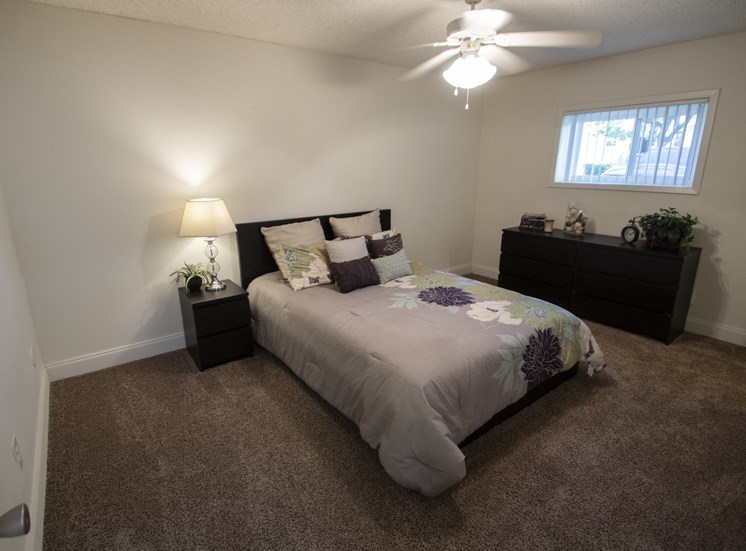 This is a photo of the bedroom in the 653 square foot 1 bedroom apartment at Princeton Court Apartments in Dallas, TX.