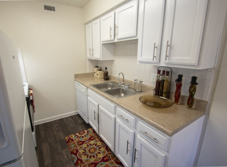 This is a photo of the kitchen in the 653 square foot 1 bedroom apartment at Princeton Court Apartments in Dallas, TX.