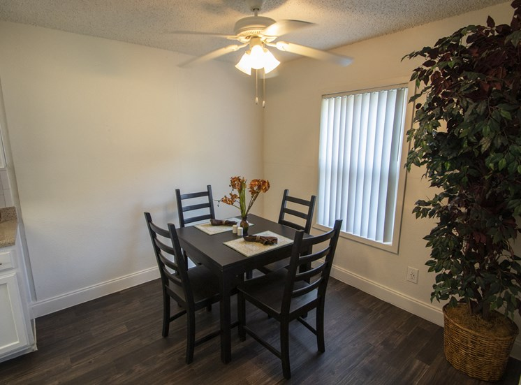 This is a photo of the dining room in the 653 square foot 1 bedroom apartment at Princeton Court Apartments in Dallas, TX.