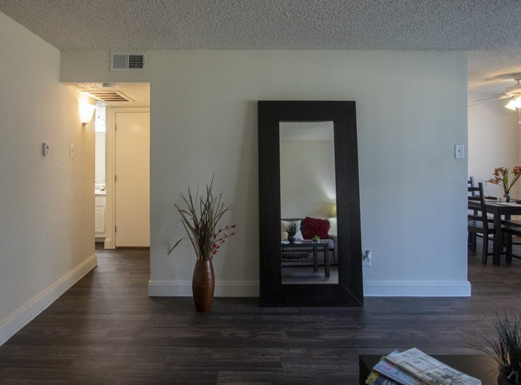This is a photo of the living room in the 653 square foot 1 bedroom apartment at Princeton Court Apartments in Dallas, TX.