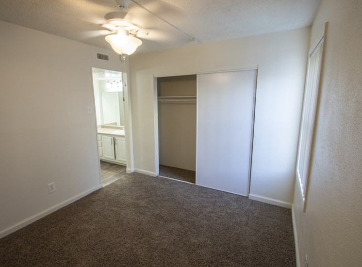 This is a photo of the bedroom in the 472 square foot 1 bedroom apartment at Princeton Court Apartments in Dallas, TX.