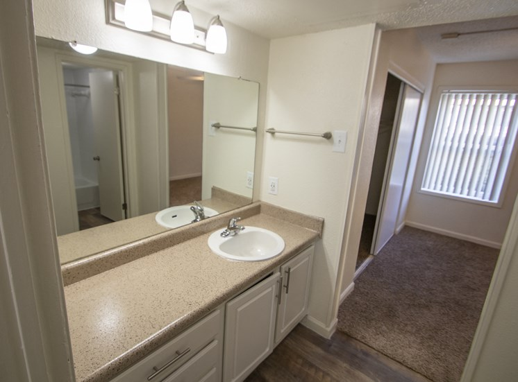 This is a photo of the bathroom vanity in the 472 square foot 1 bedroom apartment at Princeton Court Apartments in Dallas, TX.
