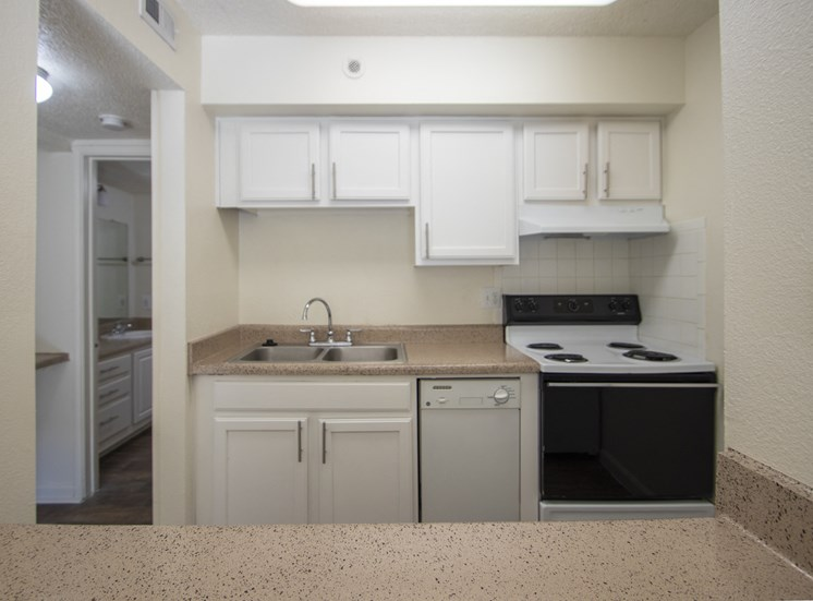 This is a photo of the kitchen in the 472 square foot 1 bedroom apartment at Princeton Court Apartments in Dallas, TX.