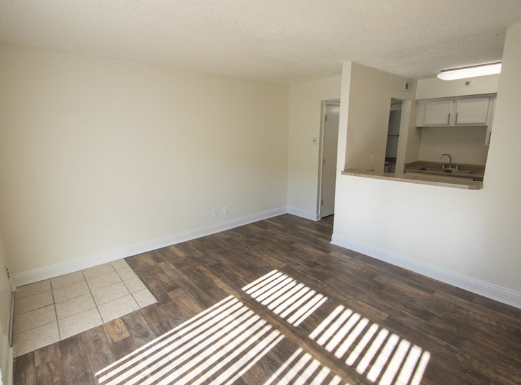 This is a photo of the living room in the 472 square foot 1 bedroom apartment at Princeton Court Apartments in Dallas, TX.