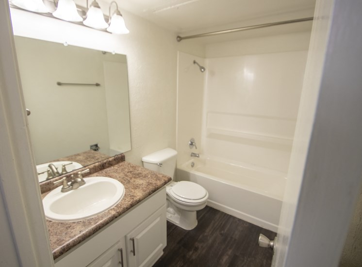 This is a photo of the bathroom in the 1060 square foot 2 bedroom apartment at Princeton Court Apartments in Dallas, TX.
