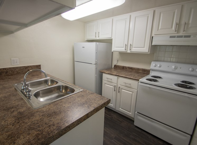 This is a photo of the kitchen in the 1060 square foot 2 bedroom apartment at Princeton Court Apartments in Dallas, TX.
