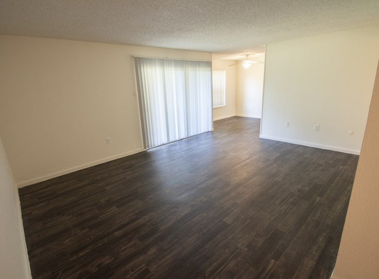This is a photo of the living room and dining area in the 1060 square foot 2 bedroom apartment at Princeton Court Apartments in Dallas, TX.