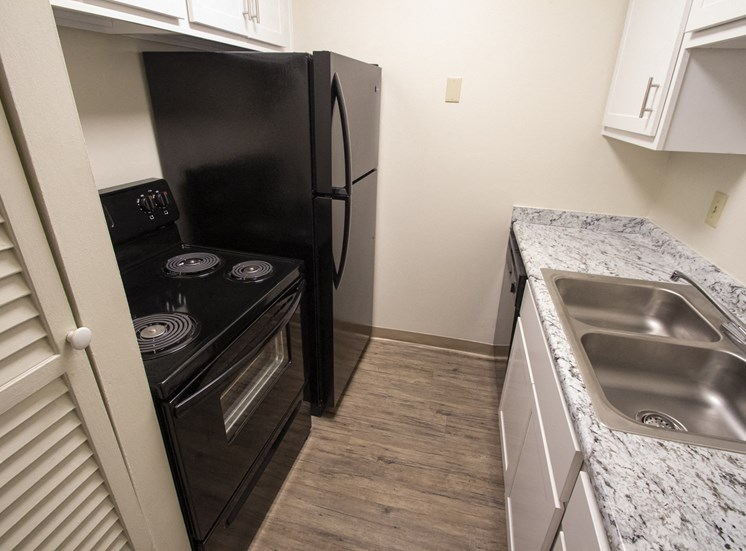 This is a photo of the kitchen in a 849 square foot 2 bedroom, 2 bath apartment at Park Lane Apartments in Cincinnati, OH.