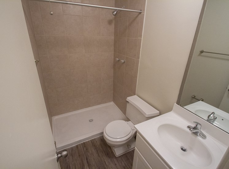 This is a photo of the bathroom with stand up shower in a 849 square foot 2 bedroom, 2 bath apartment at Park Lane Apartments in Cincinnati, OH.