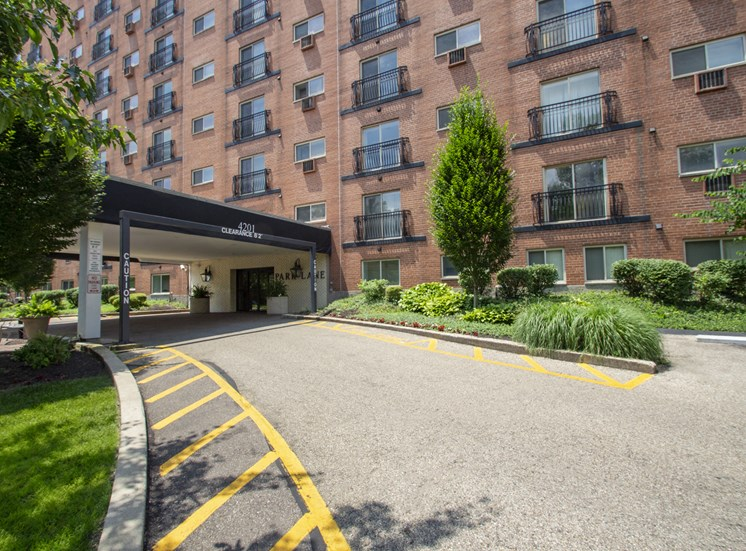 This is a photo of the building exterior showing the entrance to Park Lane Apartments in Cincinnati, OH.