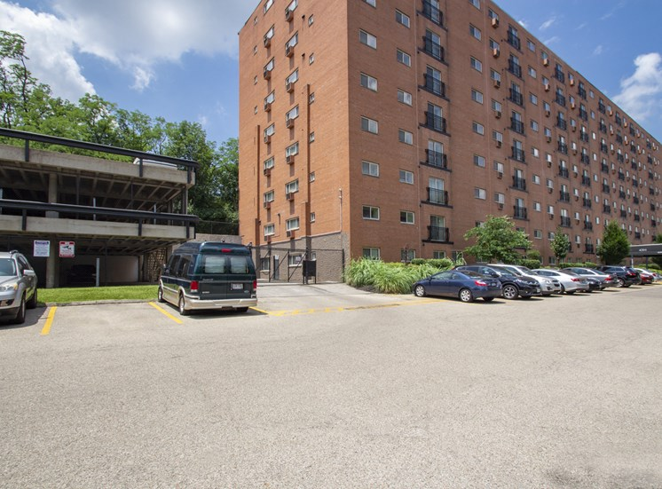 This is a photo of the building exterior showing the parking garage to Park Lane Apartments in Cincinnati, OH.