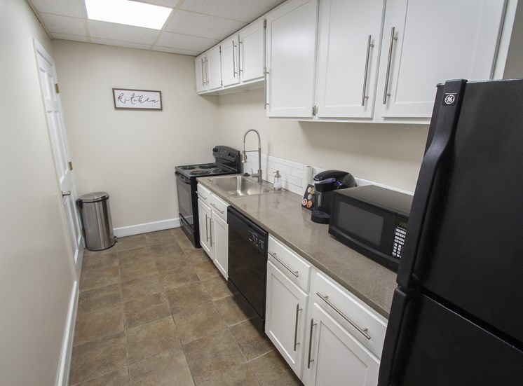 This is a photo of the kitchen in the resident social room at Park Lane Apartments in Cincinnati, OH.