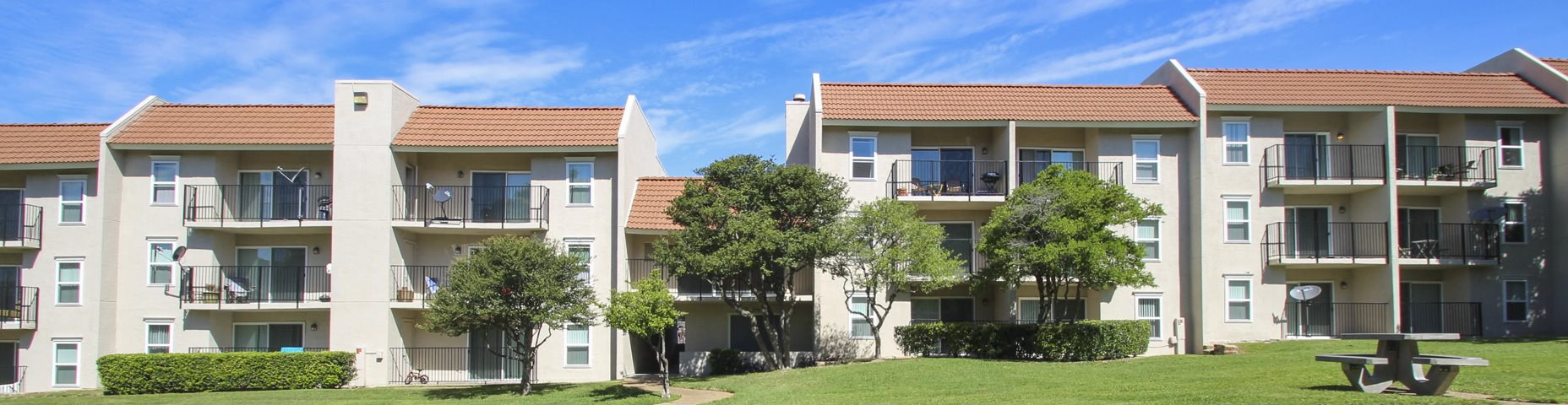 This is a photo of a building exterior at Princeton Court Apartments in Dallas, TX.
