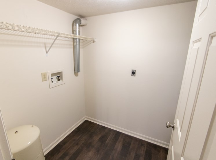 This is photo of the utility room with washer and dryer connections in the 1056 square foot, 2 bedroom Gainsway floor plan at Trails of Saddlebrook Apartments in Florence, KY.