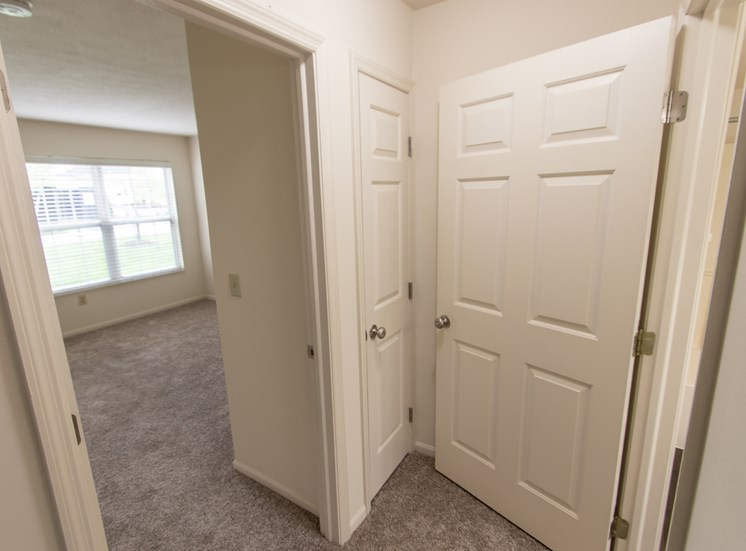 This is photo of the hallway in the 1056 square foot, 2 bedroom Gainsway floor plan at Trails of Saddlebrook Apartments in Florence, KY.