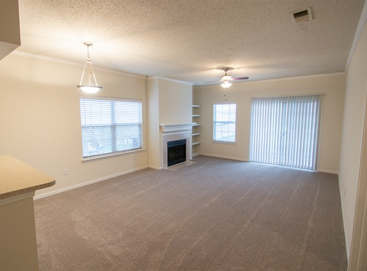 This is a photo of the dining area and living room in the 1025 square foot 2 bedroom Tranquility floor plan at The Sanctuary at Fishers Apartments in Fishers, IN.