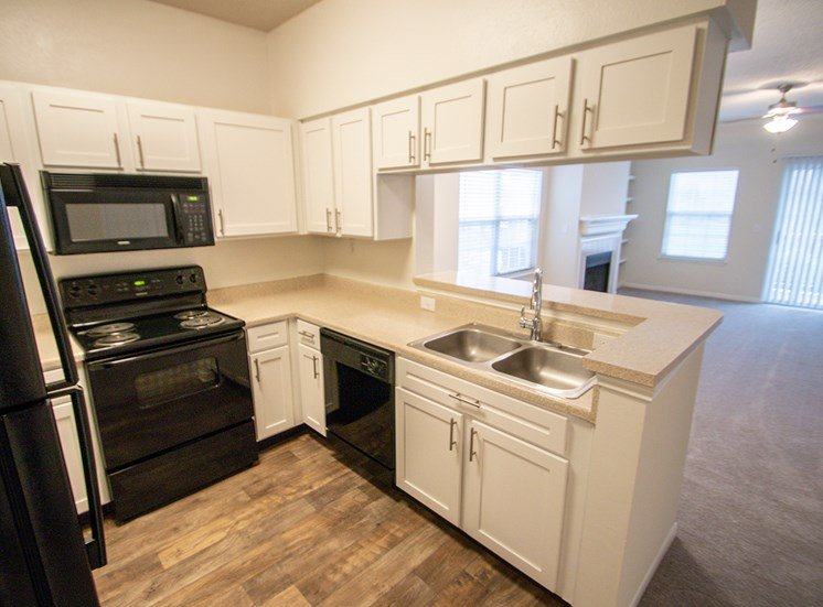 This is a photo of the kitchen in the 1025 square foot 2 bedroom Tranquility floor plan at The Sanctuary at Fishers Apartments in Fishers, IN.