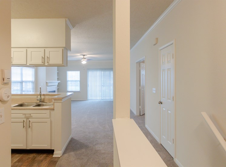 This is a photo looking towards the living room from the hallway of the 1025 square foot 2 bedroom Tranquility floor plan at The Sanctuary at Fishers Apartments in Fishers, IN.