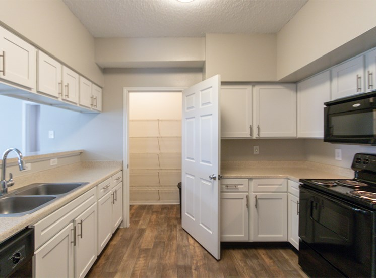 This is a photo of the kitchen in the 1515 square foot 3 bedroom Zen floor plan at The Sanctuary at Fishers Apartments in Fishers, IN.