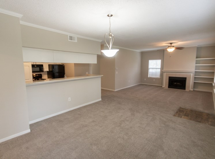 This is a photo of the dining room and living room in the 1515 square foot 3 bedroom Zen floor plan at The Sanctuary at Fishers Apartments in Fishers, IN.