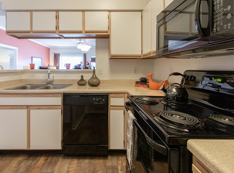 This is a photo of the kitchen in the 1135 square foot 2 bedroom Retreat floor plan at The Sanctuary at Fishers Apartments in Fishers, IN.