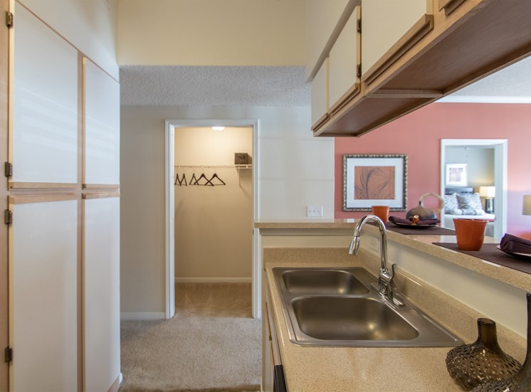 This is a photo of the hallway closet from the kitchen in the 1135 square foot 2 bedroom Retreat floor plan at The Sanctuary at Fishers Apartments in Fishers, IN.