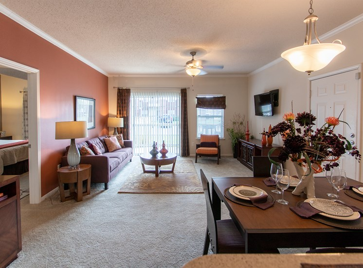This is a photo of the dining area and living room in the 1135 square foot 2 bedroom Retreat floor plan at The Sanctuary at Fishers Apartments in Fishers, IN.