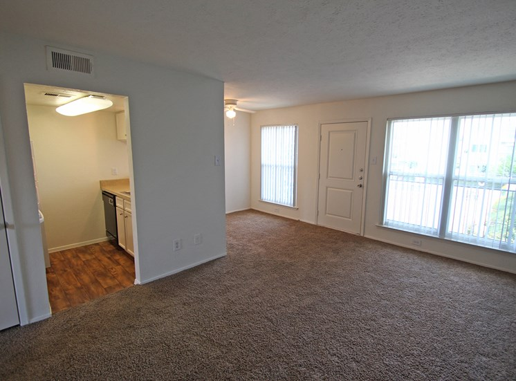 This is a photo of the living room from the dining area in a 576 square foot 1 bedroom apartment at The Summit at Midtown Apartments in Dallas, TX.