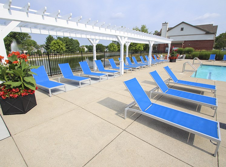 This is a photo of the pool deck at the Sanctuary at Fishers Apartments in Fishers, IN.