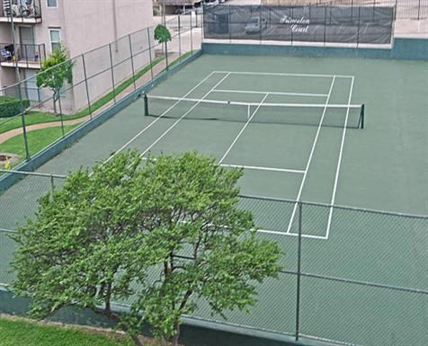 This is a photo of the tennis courts from above at Princeton Court Apartments in Dallas, TX.