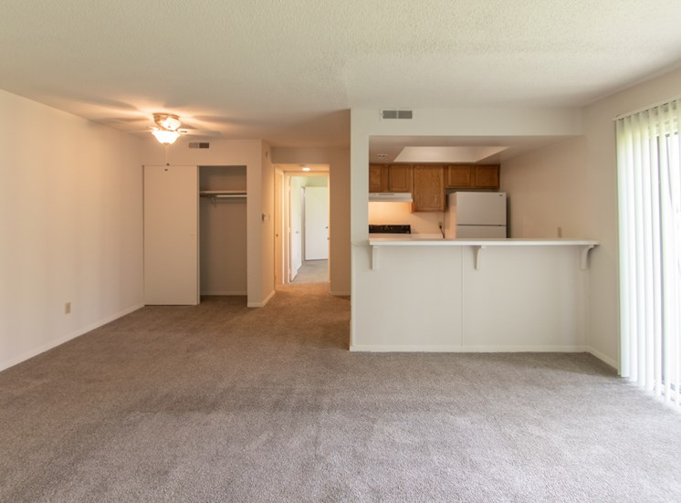 This is a photo of the living room and dining area in the  684 square foot, 1 bedroom floor plan at Village East Apartments in Franklin, OH.