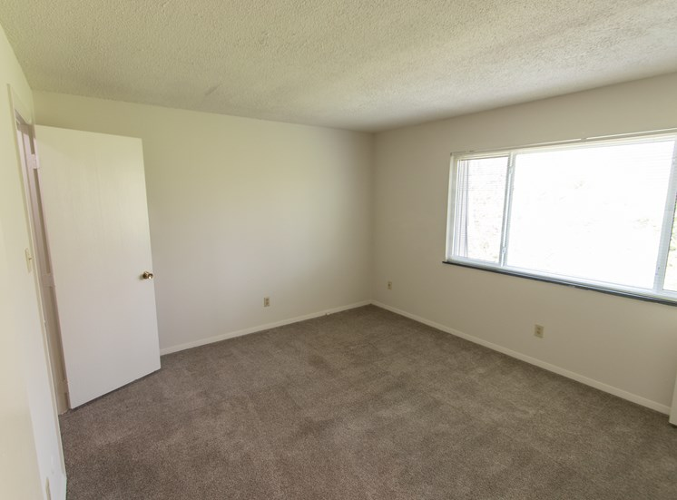 This is a photo of the bedroom in the  684 square foot, 1 bedroom floor plan at Village East Apartments in Franklin, OH.