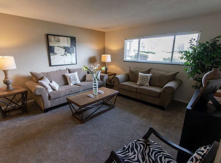 This is a photo of the living room in the  822 square foot, 2 bedroom floor plan at Village East Apartments in Franklin, OH.