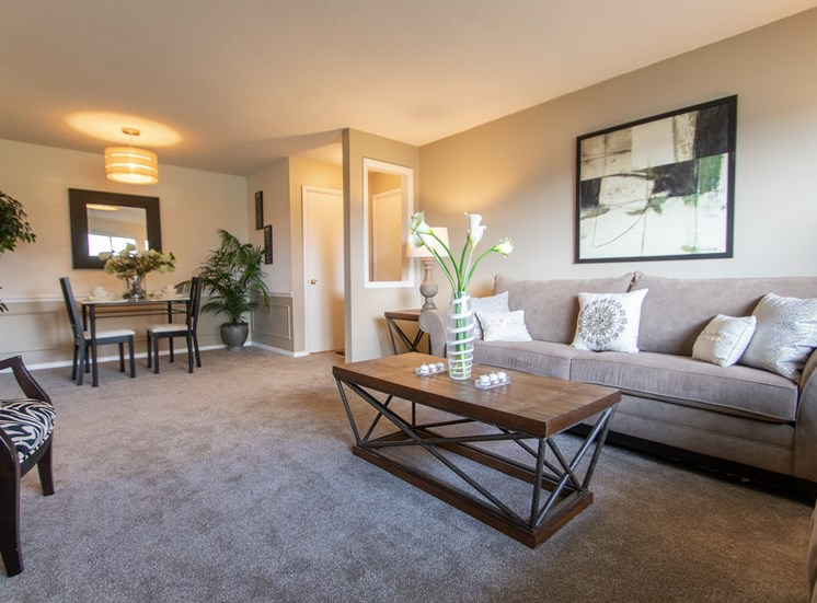 This is a photo of the living room and dining area in the  822 square foot, 2 bedroom floor plan at Village East Apartments in Franklin, OH.