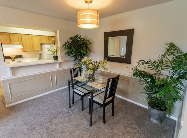 This is a photo of the dining area in the  822 square foot, 2 bedroom floor plan at Village East Apartments in Franklin, OH.