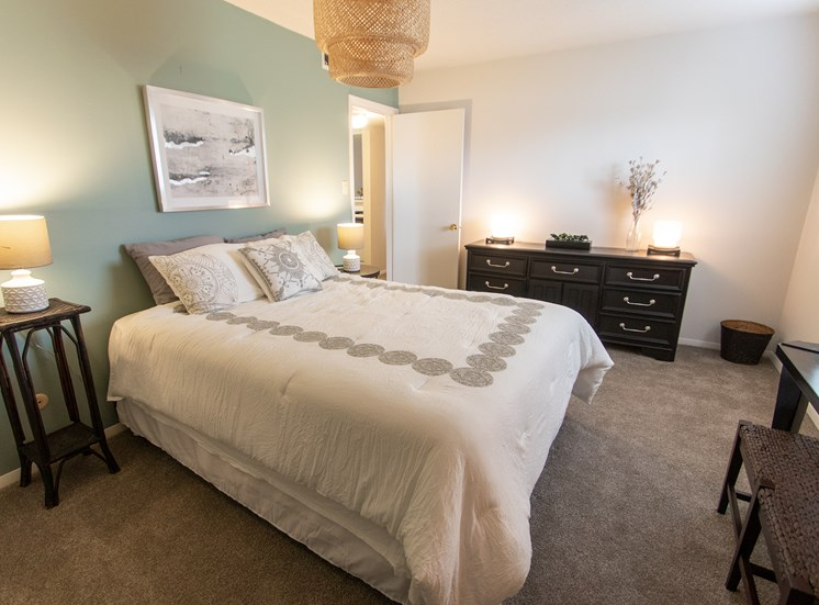 This is a photo of the master bedroom in the  822 square foot, 2 bedroom floor plan at Village East Apartments in Franklin, OH.