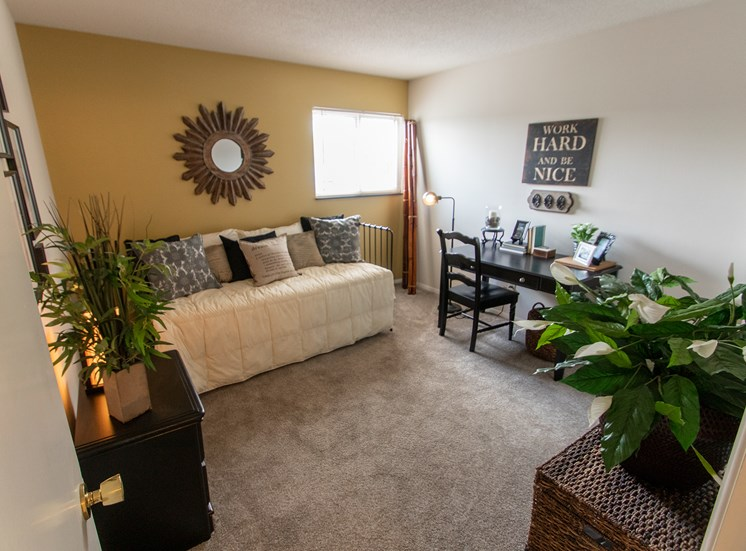 This is a photo of the bedroom in the  822 square foot, 2 bedroom floor plan at Village East Apartments in Franklin, OH.