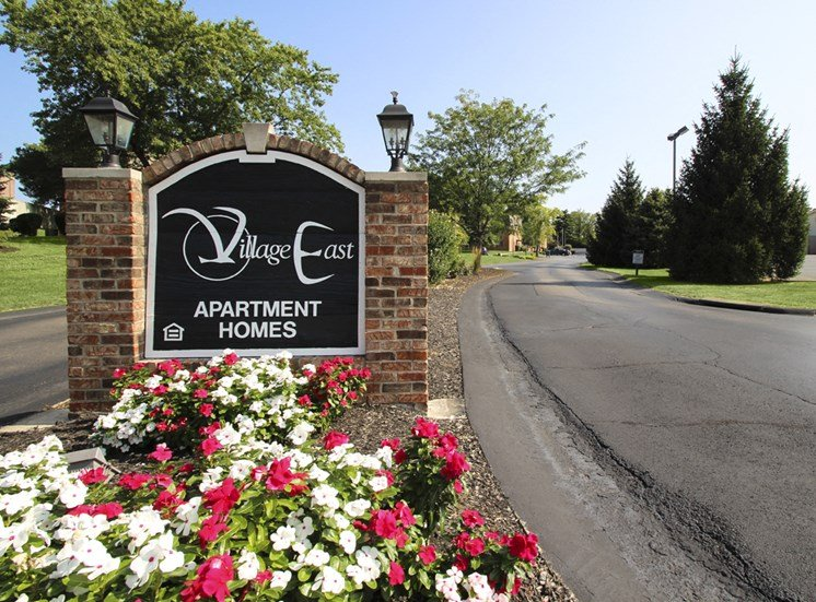 This is a photo of the entrance sign at Village East Apartments in Franklin, OH.