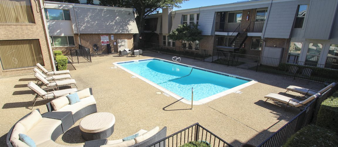 This is a photo of the outdoor furniture in the pool area at Woodbridge Apartments in Dallas, TX